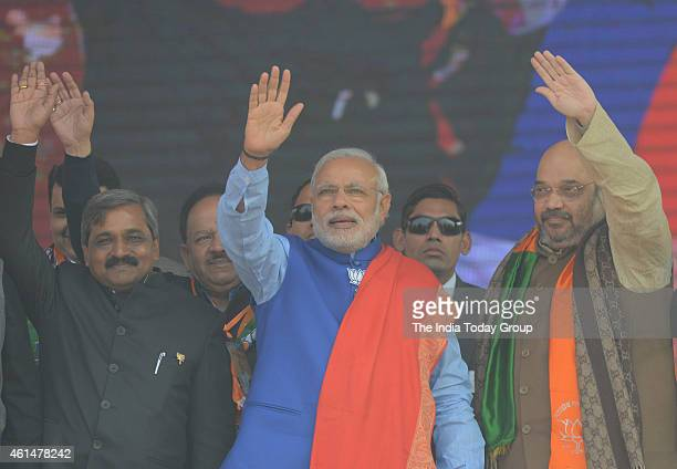 Prime Minister Narendra ModiAmit Shah and Satish Upadhyay during the BJP's 'Abhinandan' rally in New Delhi