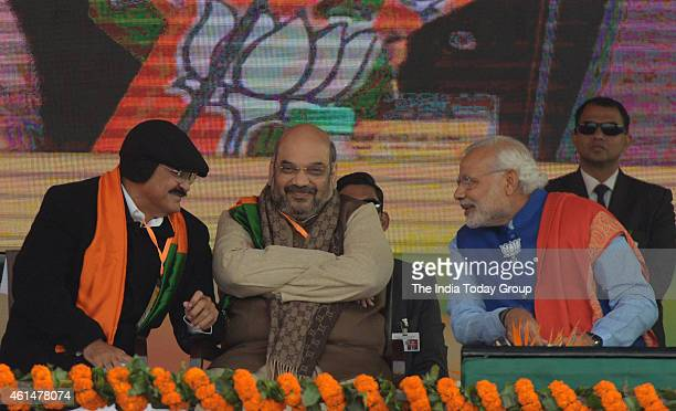 Prime Minister Narendra ModiMVenkaiah Naidu and party president Amit Shah during the BJP's 'Abhinandan' rally in New Delhi