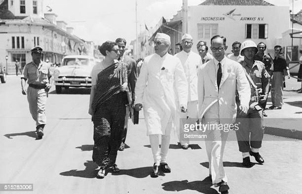 Prime Minister Nehru of India and his daughter Indira Gandhi walked from the meeting hall of the African Asian Conference to their hotel after one of...