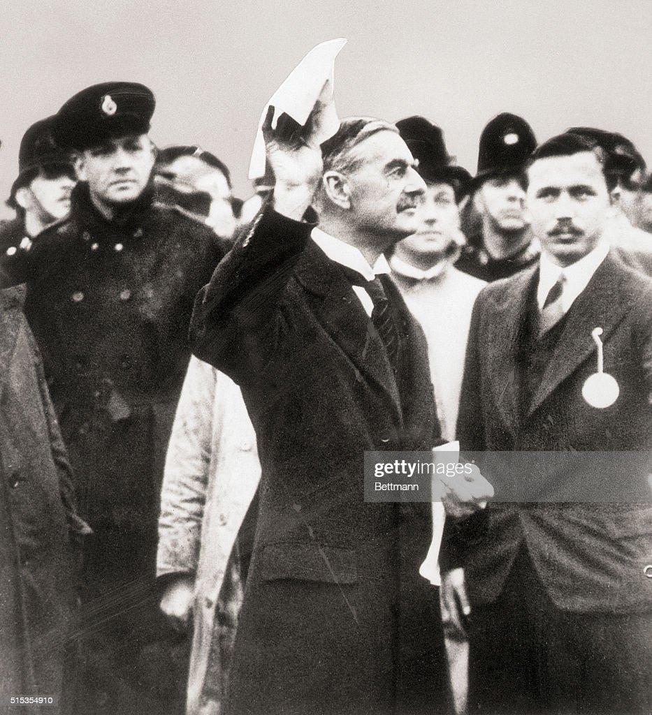 Prime Minister Neville Chamberlain Arrives In London Holding The