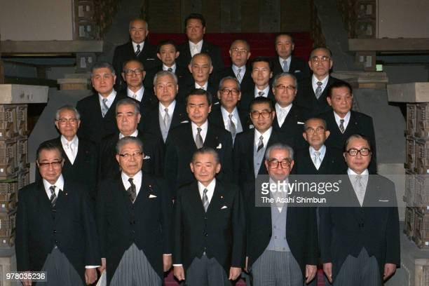 Prime Minister Noboru Takeshita and his new cabinet members pose for photographs at the prime minister's official residence on December 27 1988 in...