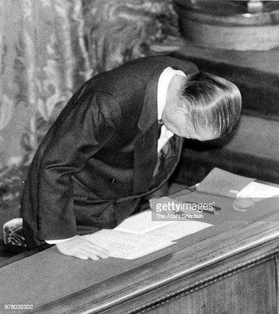 Prime Minister Noboru Takeshita bows after the consumption tax bills enacted at an Upper House plenary session at the Diet on December 24 1988 in...