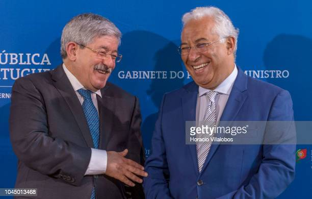 Prime Minister of Algeria Ahmed Ouyahia and Portugal's Prime Minister Antonio Costa share a laugh while waiting for documents to be signed by both...