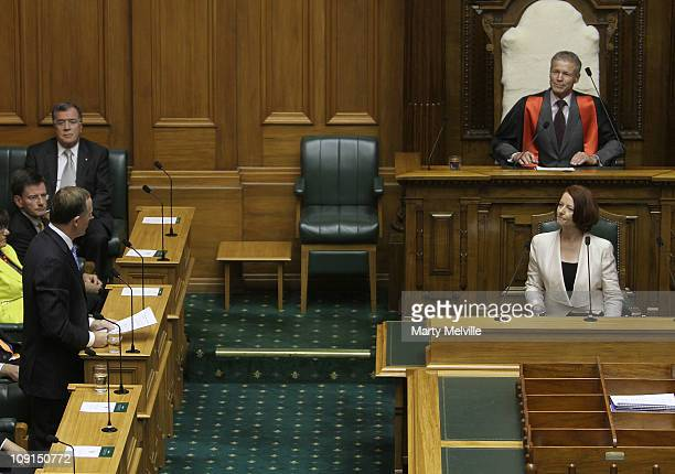 Prime Minister of Australia Julia Gillard listens to a reply by Prime Minister of New Zealand John Key during an address to the House at Parliament...