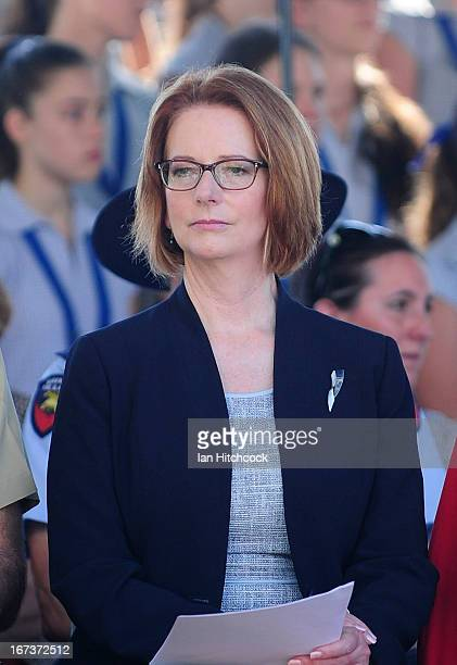 Prime Minister of Australia Julia Gillard sits during a commemorative service on April 25 2013 in Townsville Australia Veterans dignitaries and...