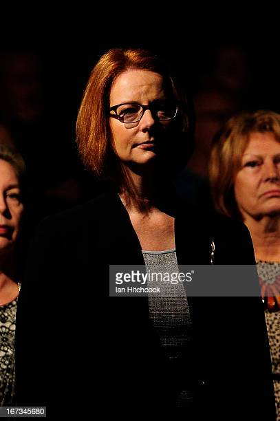Prime Minister of Australia Julia Gillard stands during the dawn service on April 25 2013 in Townsville Australia Veterans dignitaries and members of...