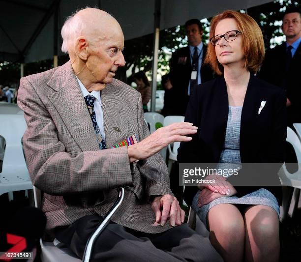 Prime Minister of Australia julia Gillard talks with former POW Sidney King at the dawn service on April 25 2013 in Townsville Australia Veterans...