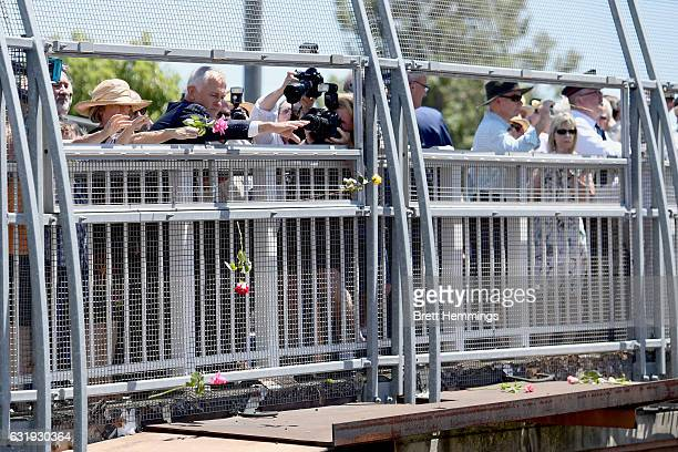 Prime Minister of Australia Malcolm Turnbull and Ms Lucy Turnbull drop a rose onto the tracks during the 40th anniversary memorial service for the...