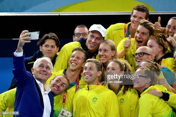 Prime Minister of Australia Malcolm Turnbull takes a selfie with members of team Australia on day six of the Gold Coast 2018 Commonwealth Games at...
