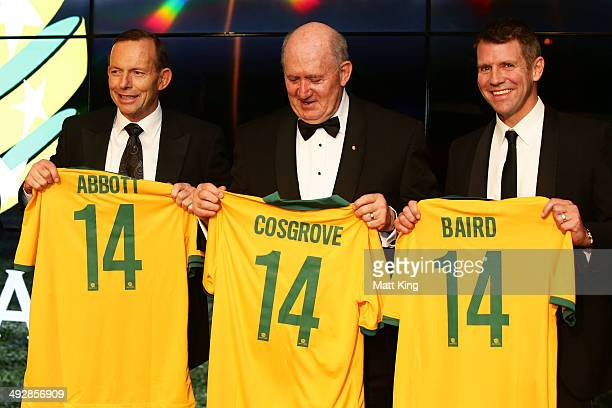 Prime Minister of Australia Tony Abbott GovernorGeneral of Australia Peter Cosgrove and NSW Premier Mike Baird are presented with Socceroos jerseys...