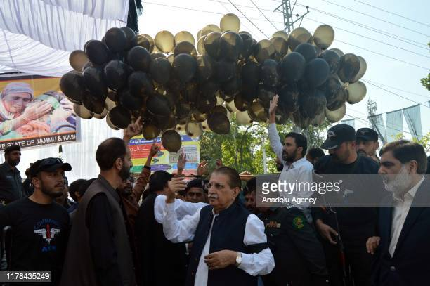 Prime Minister of Azad Jammu And Kashmir Raja Muhammad Farooq Haider Khan attends a demonstration to mark Black Day in Muzaffarabad the capital of...