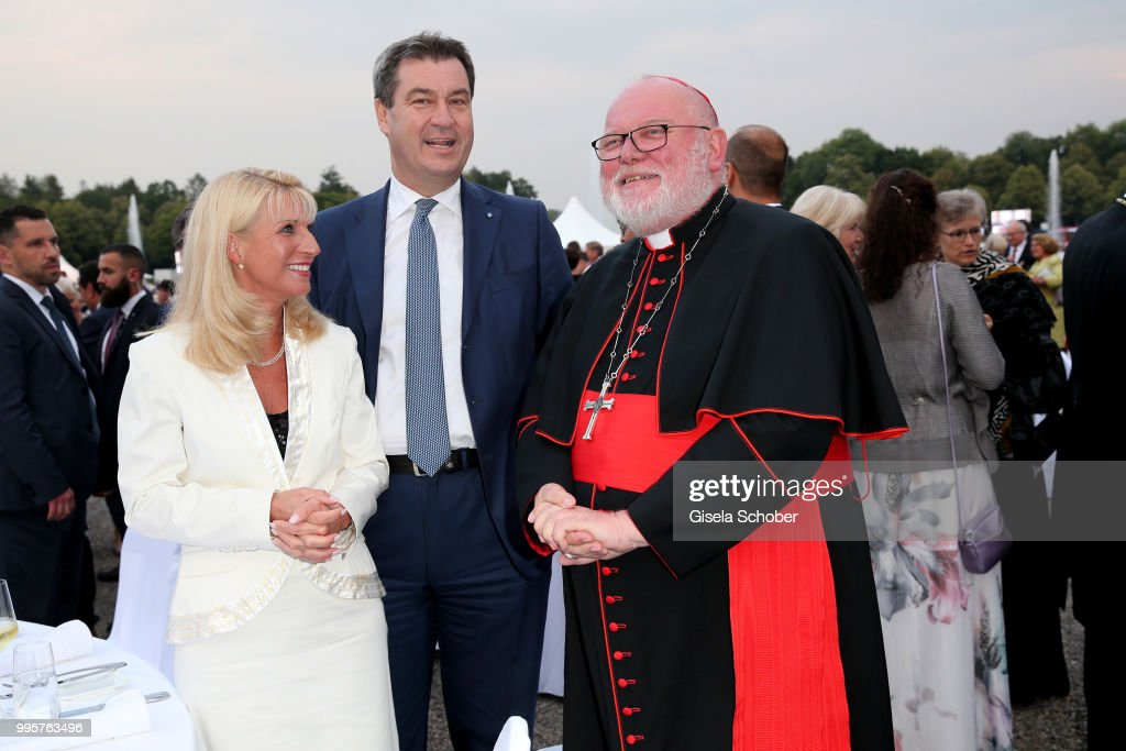 Prime minister of Bavaria Dr. Markus Soeder and his wife Karin Soeder and Kardinal Reinhard Marx during the Summer Reception of the Bavarian State Parliament (Empfang des Bayerischen Landtags) at Schleissheim Palace on July 10, 2018 in Munich, Germany.