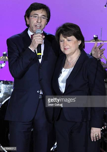 Prime Minister of Belgium and leader of the Socialist Party Elio Di Rupo and First Secretary of the French Socialist Party Martine Aubry speak at...