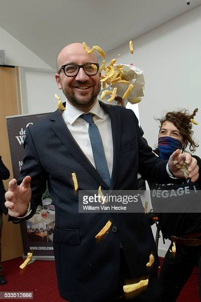 Prime Minister of Belgium Charles Michel pictured during a Femen attack Activists threw French Fries and mayonaise towards the Prime Minister during...