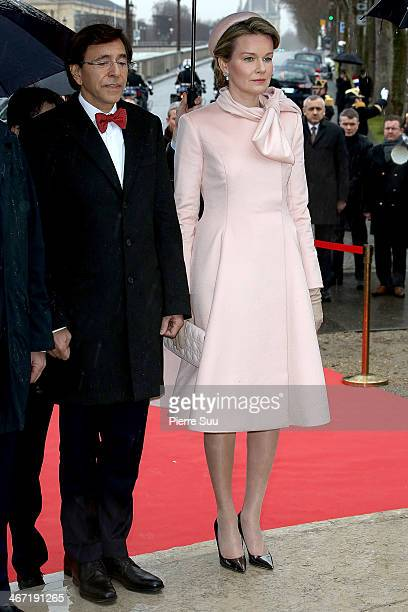 Prime Minister of Belgium Elio Di Rupo and Queen Mathilde Of Belgium Lay a wreath at the foot of the statue of King Albert I on a one day official...