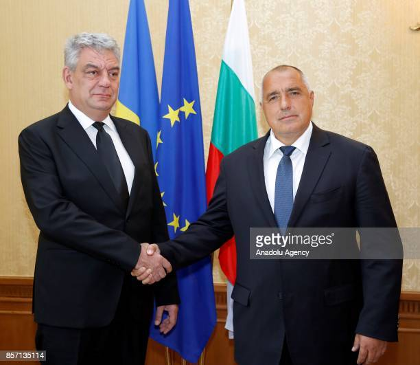 Prime Minister of Bulgaria Boyko Borisov shakes hands with Prime Minister of Romania Mihai Tudose in Varna Bulgaria on October 03 2017