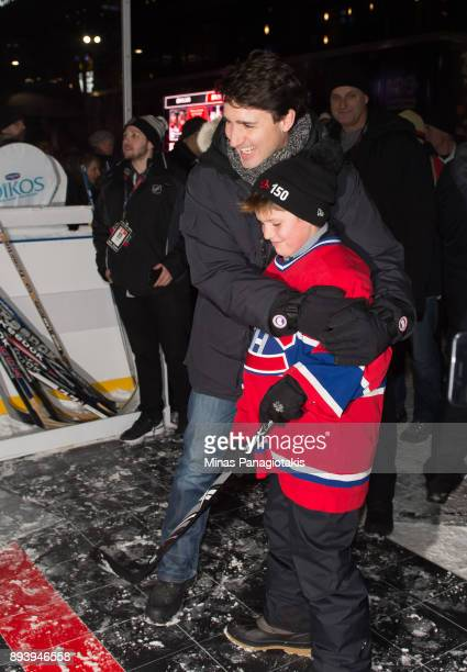Prime Minister of Canada Justin Trudeau and his son Xavier Trudeau hang out in the Centennial Fan Arena in advance of the 2017 Scotiabank NHL100...