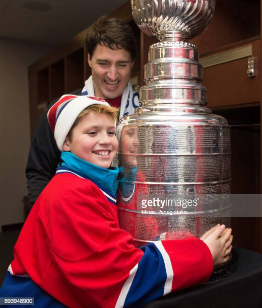 Prime Minister of Canada Justin Trudeau and his son Xavier Trudeau check out the Stanley Cup during the 2017 Scotiabank NHL100 Classic at Lansdowne...