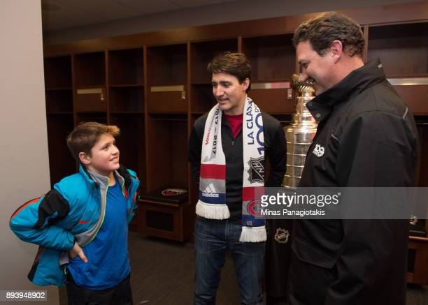 Prime Minister of Canada Justin Trudeau and his son Xavier Trudeau talk with NHL legend Mario Lemieux during the 2017 Scotiabank NHL100 Classic at...