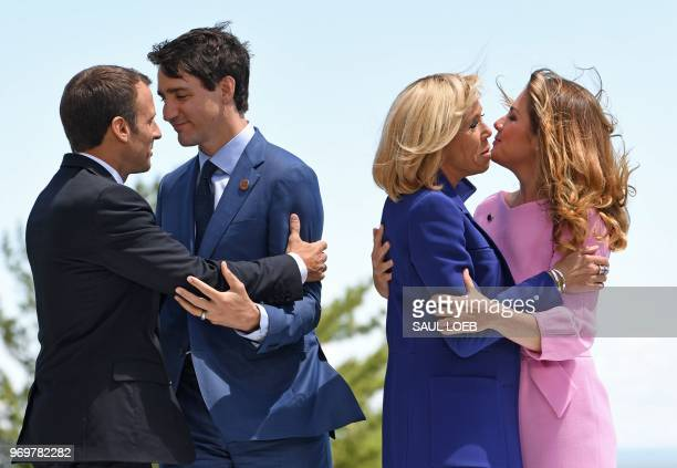 TOPSHOT Prime Minister of Canada Justin Trudeau and his wife Sophie Gregoire Trudeau welcome French President Emmanuel Macron and his wife Brigitte...