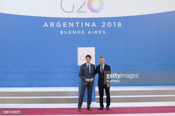 Prime Minister of Canada Justin Trudeau greets Aregintina's President Mauricio Macri during the welcoming ceremony prior to the G20 Summit's Plenary...