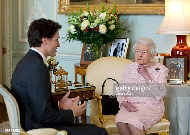 Prime Minister of Canada Justin Trudeau meets Queen Elizabeth II during a private audience at Buckingham Palace on November 25 2015 in London England...