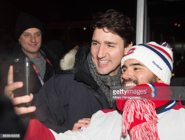 Prime Minister of Canada Justin Trudeau poses with fans in advance of the 2017 Scotiabank NHL100 Classic at Lansdowne Park on December 16 2017 in...