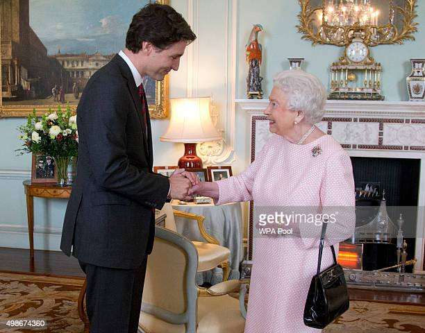 Prime Minister of Canada Justin Trudeau shake hands with Queen Elizabeth II during a private audience at Buckingham Palace on November 25 2015 in...