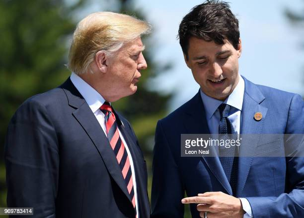 Prime Minister of Canada Justin Trudeau speaks with US President Donald Trump during the G7 official welcome at Le Manoir Richelieu on day one of the...