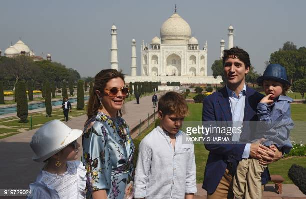 Prime Minister of Canada Justin Trudeau talks to the media during a visit to the Taj Mahal with his wife Sophie Gregoire and their children in Agra...