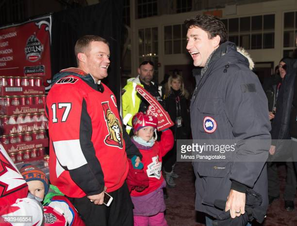 Prime Minister of Canada Justin Trudeau talks with fans in advance of the 2017 Scotiabank NHL100 Classic at Lansdowne Park on December 16 2017 in...