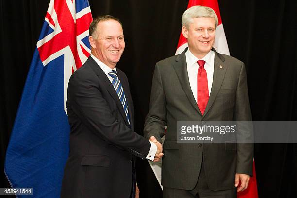Prime Minister of Canada Stephen Harper shakes hands with Prime Minister of New Zealand John Key after arriving in Auckland on November 14 2014 at...