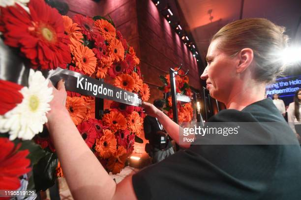 Prime Minister of Denmark Mette Frederiksen positions a wreath at the 5th World Holocaust Forum at Yad Vashem Holocaust memorial museum on January 23...