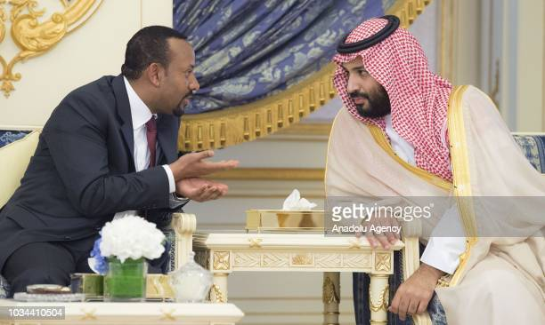 Prime Minister of Ethiopia Abiy Ahmed chats with Crown Prince and Defense Minister of Saudi Arabia Mohammad bin Salman alSaud during a signing...