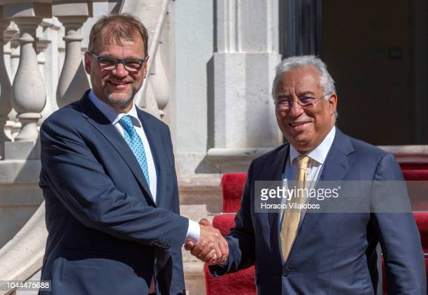 Prime Minister of Finland Juha Sipila and Portugal's Prime Minister Antonio Costa shake hands for pictures while arriving together for a working...