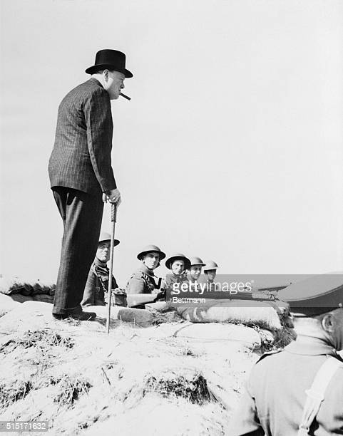 Prime Minister of Great Britain, Winston Churchill reviewing the wartime defense of England.