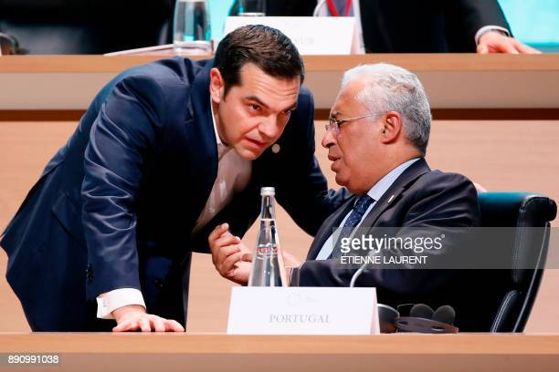 Prime Minister of Greece Alexis Tsipras speaks with his Portuguese counterpart Antonio Costa during the Plenary Session of the One Planet Summit at...