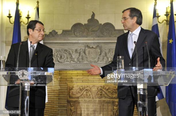 Prime Minister of Greece Antonis Samaras and President of Cyprus Nikos Anastasiades holds a press conference after their meeting in the Villa Maximos...