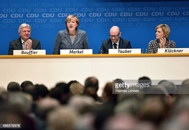 Prime Minister of Hessen Volker Bouffier Peter Tauber and Julia Kloeckner applaud the German Chancellor and Chairwoman of the German Christian...
