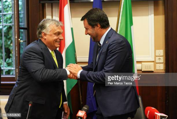 Prime Minister of Hungary Viktor Orban and Italian Minister of Internal Affairs Matteo Salvini shake hands at the end of the press conference at...