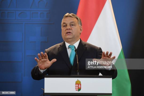 Prime Minister of Hungary Viktor Orban gestures as he gives a joint press conference with his Polish counterpart at the Hungarian parliament in...