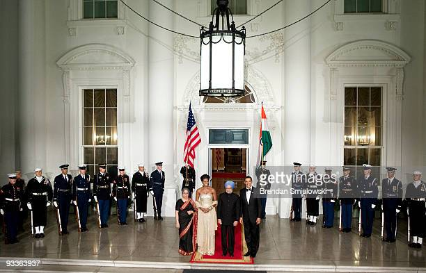 Prime Minister of India Manmohan Singh and his wife Gursharan Kaur stand with US President Barack Obama and first lady Michelle Obama before a state...