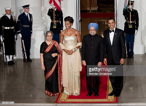 Prime Minister of India Manmohan Singh and his wife Gursharan Kaur stand with President Barack Obama and first lady Michelle Obama before a state...