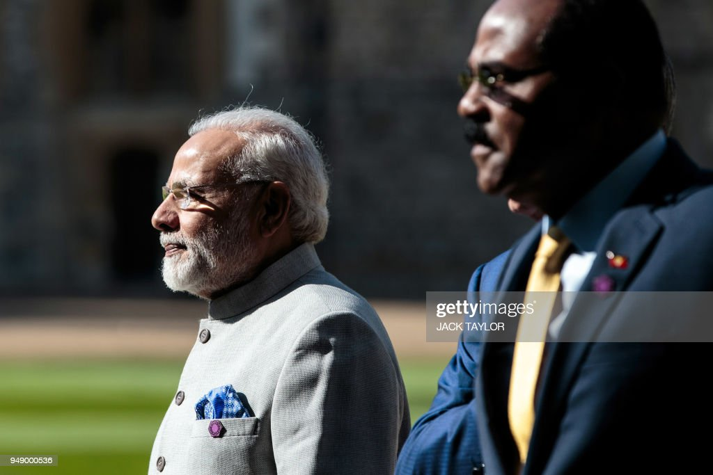 Prime Minister of India Narendra Modi (L) and Prime Minister of Antigua and Barbuda Gaston Browne arrive at Windsor Castle for a Commonwealth Heads of Government meeting (CHOGM) retreat in Windsor, west of London on April 20, 2018.