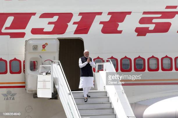 Prime Minister of India Narendra Modi gestures as he gets off a plane on his arrival to Buenos Aires for G20 Leaders' Summit 2018 at Ministro...