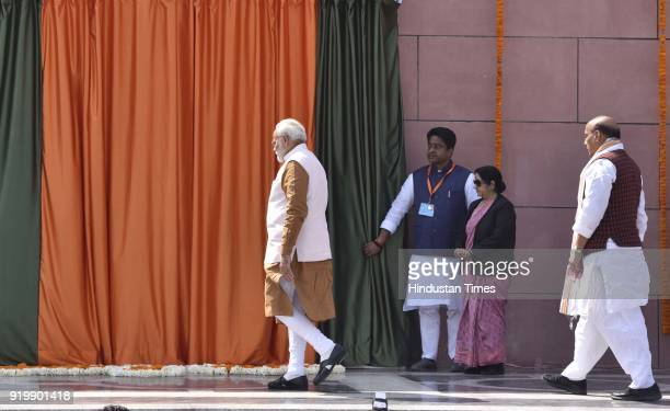 Prime Minister of India Narendra Modi with Union Home Minister Rajnath Singh during the inauguration of BJP headquarter building at 6A Deen Dayal...
