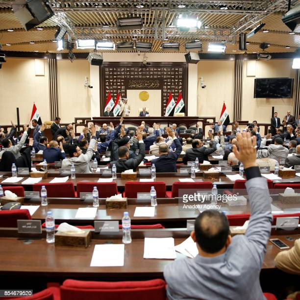 Prime Minister of Iraq Haider alAbadi and speaker of the Iraqi Parliament Salim alJabouri attend a session at the Iranian parliament building...