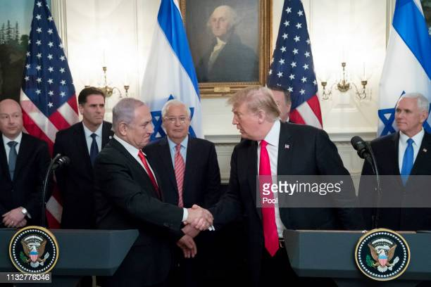 Prime Minister of Israel Benjamin Netanyahu and US President Donald J Trump shake hands before Trump signed an order recognizing Golan Heights as...