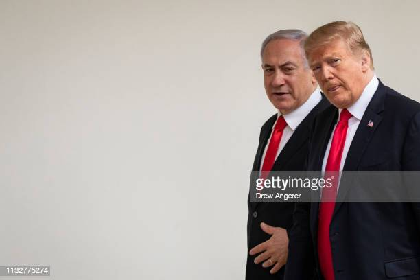 Prime Minister of Israel Benjamin Netanyahu and US President Donald Trump walk through the colonnade prior to an Oval Office meeting at the White...
