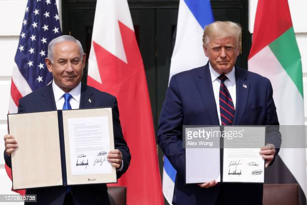 Prime Minister of Israel Benjamin Netanyahu and U.S. President Donald Trump participate in the signing ceremony of the Abraham Accords on the South...